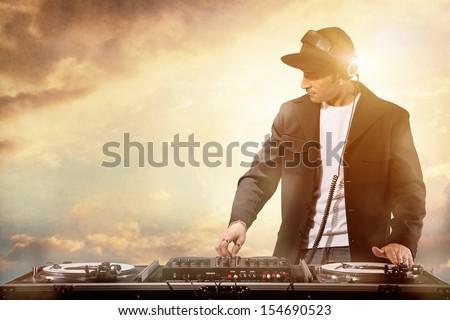 Photo of dj working at sunset - stock photo