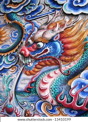 photo of dragon face on the wall - stock photo
