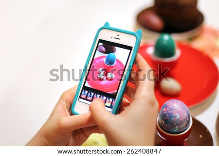 Photo of Easter eggs on the phone. - stock photo