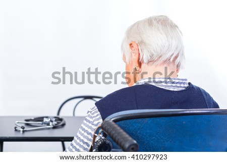 Photo of elderly woman waiting for the doctor - stock photo
