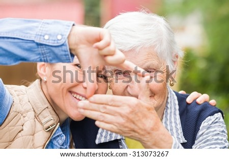 Photo of elderly woman with grandchild having funny - stock photo
