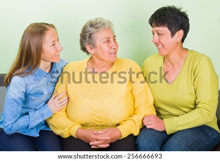 Photo of elderly woman with her daughters - stock photo