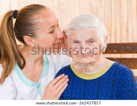 Photo of elderly woman with the young carer - stock photo
