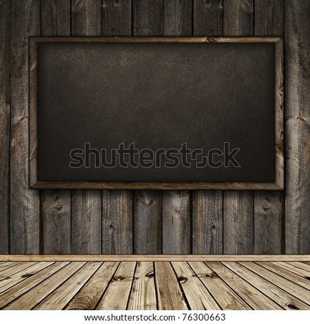 Photo of empty natural wooden interior with blackboard - stock photo