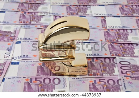 photo of 500 euro bills and gold euro sign - stock photo
