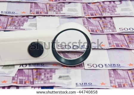 photo of 500 euro bills and magnifying glass vista - stock photo