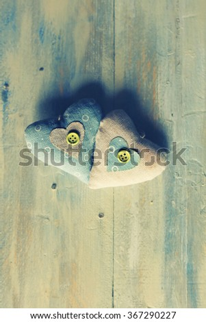 Photo of fabric heart on wooden background - stock photo