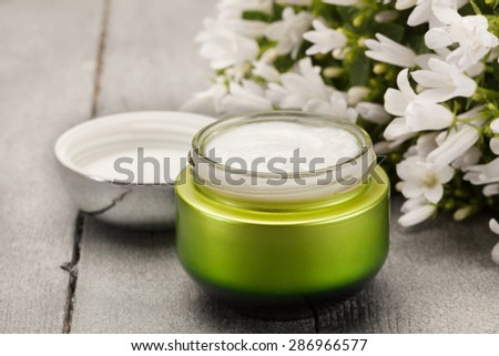 Photo of face cream over wooden table - stock photo