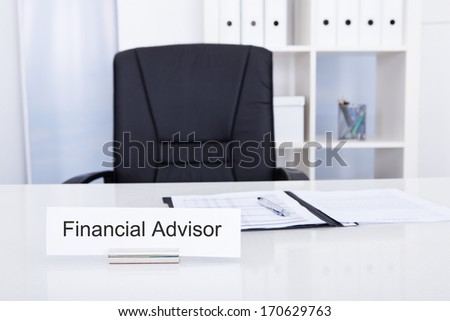 Photo Of Financial Advisor On Nameplate At Workplace - stock photo