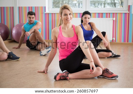 Photo of fit people stretching legs during fitness classes - stock photo