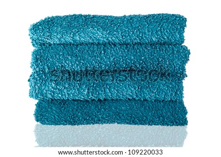 Photo of four turquoise towels with reflection isolated on white background - stock photo