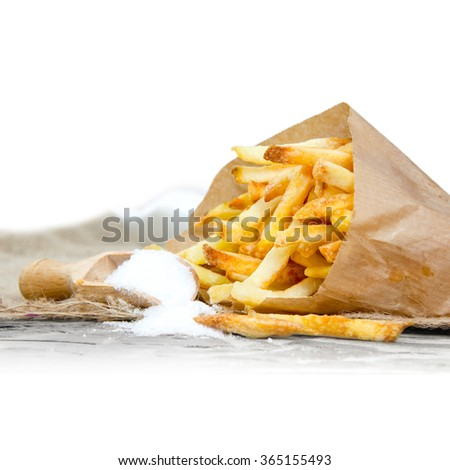 Photo of french fries with salt and white space for text - stock photo