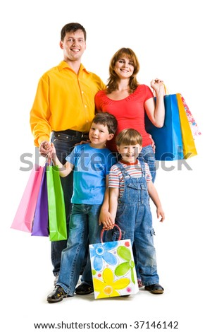 Photo of friendly parents and siblings with bags isolated over white background - stock photo