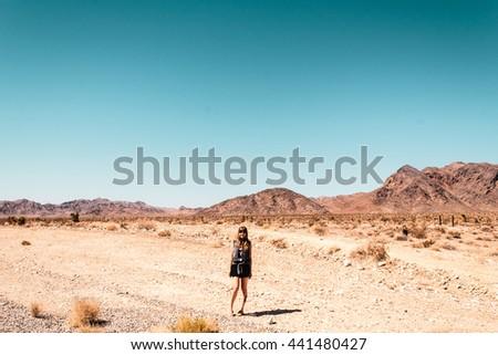Photo of Girl at Mojave Desert near Route 66 in California - stock photo