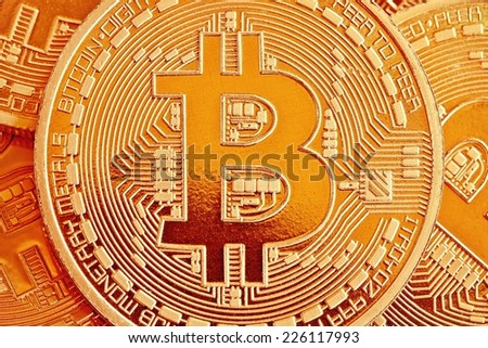 Photo of Golden Bitcoins close-up (new virtual money )  - stock photo