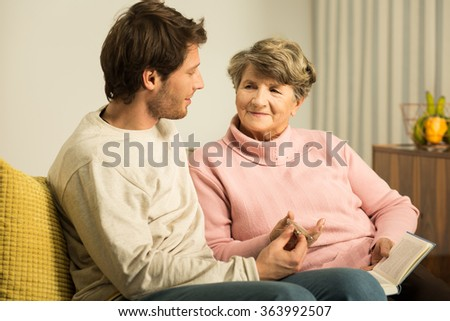 Photo of grandson supporting his ill grandmother - stock photo