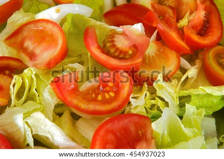photo of green salad of tomato and lettuce - stock photo