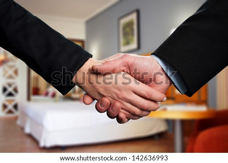 Photo of handshake of business partners - stock photo
