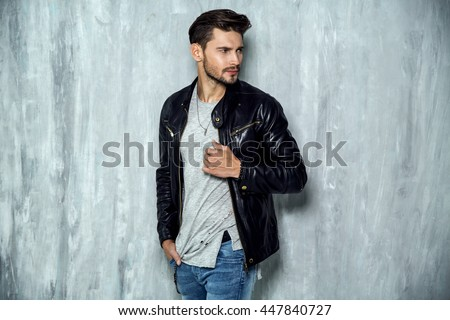 Photo of handsome man in black leather jacket - stock photo