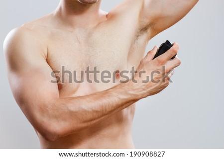 Photo of handsome man using deodorant,Man using  deodorant - stock photo