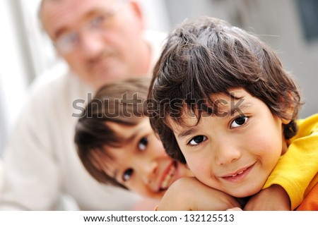 Photo of happy boys in front smiling at camera - stock photo