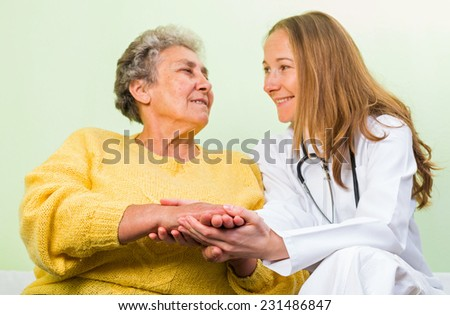 Photo of happy elderly woman with her daughter - stock photo