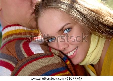 Photo of happy girl keeping her head on her boyfriend shoulder - stock photo