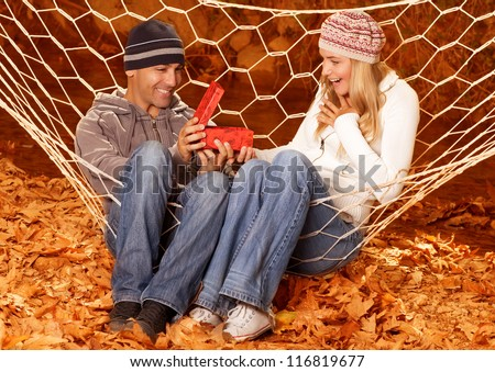 Photo of happy girl received gift for birthday from her boyfriend - stock photo