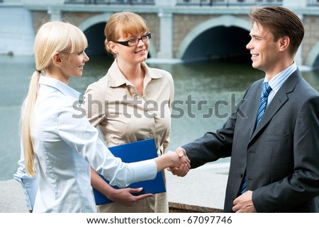 Photo of happy partners expressing trust by handshake after concluding bargain - stock photo