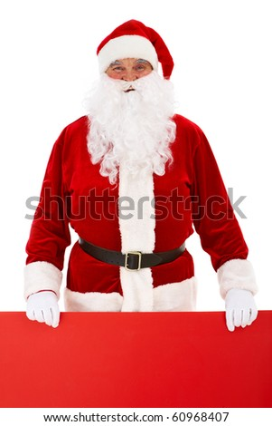 Photo of happy Santa Claus holding red billboard - stock photo