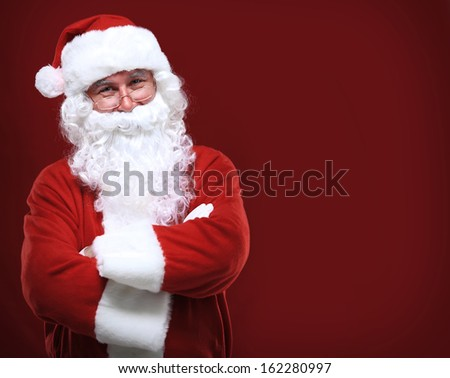 Photo of happy Santa Claus in eyeglasses looking at camera - stock photo