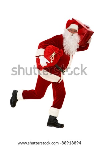 Photo of happy Santa Claus running with red giftbox and sack in hands - stock photo
