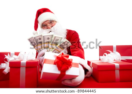 Photo of happy Santa Claus selling Christmas gifts and looking at camera - stock photo
