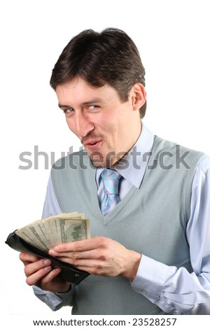 Photo of happy smilin man holding packs of dollars and looking at camera - stock photo
