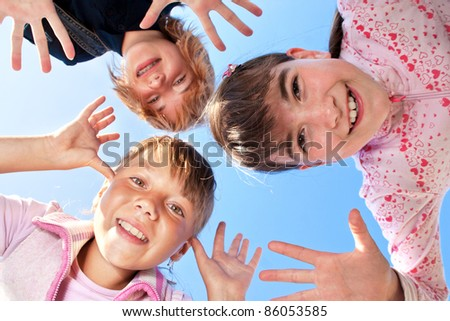 photo of happy three girls smiling at camera - stock photo