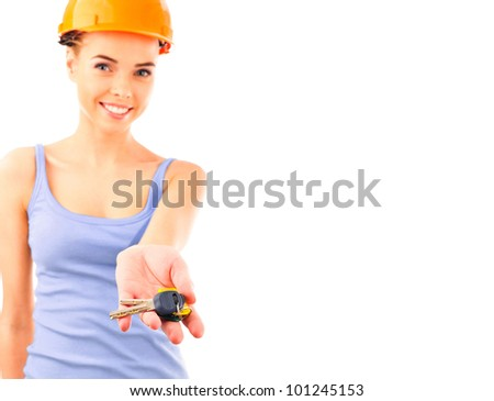 Photo of happy woman construction engineer wearing protective orange helmet holding new key and looking at camera. - stock photo