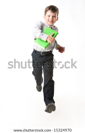 Photo of happy youngster running for a lesson at school on white background - stock photo