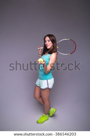 photo of Healthy sporty girl with tennis racket - stock photo