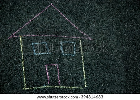 photo of House drawn by a kid on a street  - stock photo