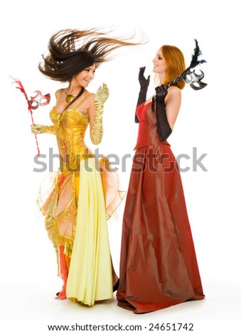 Photo of joyful actresses in fashionable dresses having fun over white background - stock photo