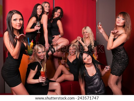Photo of joyful beautiful friends on the party communicating with each other - stock photo