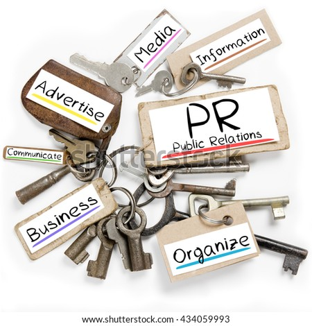 Photo of key bunch and paper tags with PR conceptual words - stock photo