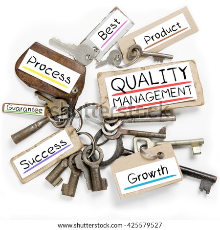 Photo of key bunch and paper tags with QUALITY MANAGEMENT conceptual words - stock photo