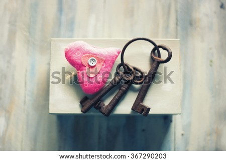 Photo of keys and heart on the white box - stock photo