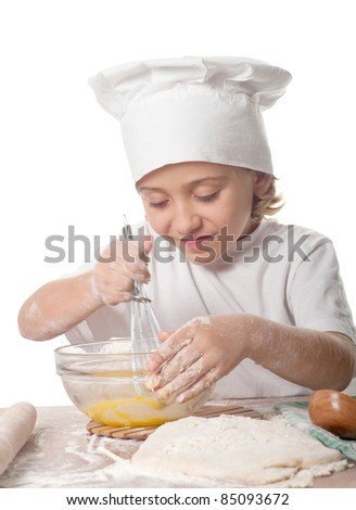 photo of little baker adorable, pretty little caucasian girl in chef hat. Cooking concept. - stock photo