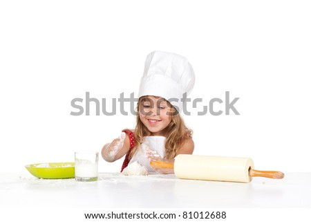 photo of little baker adorable, pretty little caucasian girl in chef hat, happy smile 4 year child mix dough, isolated over white background. Cooking concept. - stock photo