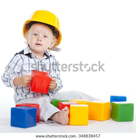 photo of little engineer plays with cubes - stock photo