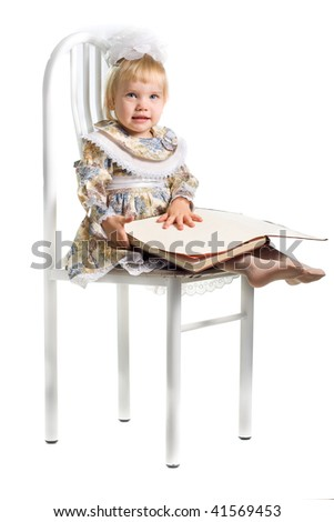 Photo of little girl with book - stock photo