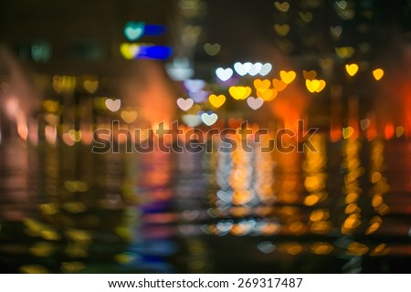Photo Of love or heart Bokeh Lights in reflection / Street Lights Out Of Focus / filtered heart blurred background  - stock photo