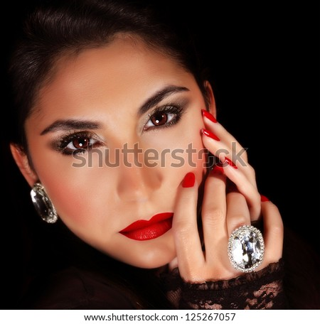 Photo of luxury female wearing stylish jewelery, closeup portrait of beautiful woman with seductive makeup isolated on black background, sexy girl, red lips, Valentine day, beauty and elegance concept - stock photo